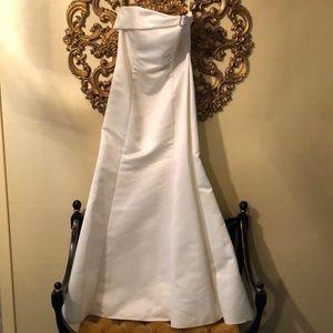 White satin strapless gown.